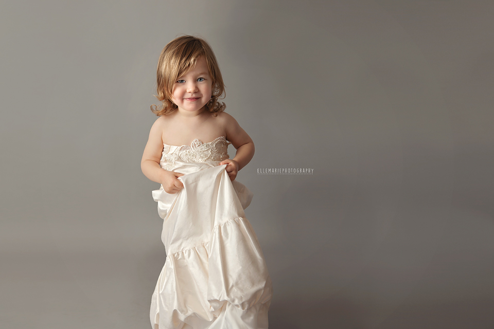toddler wearing mommy's wedding dress