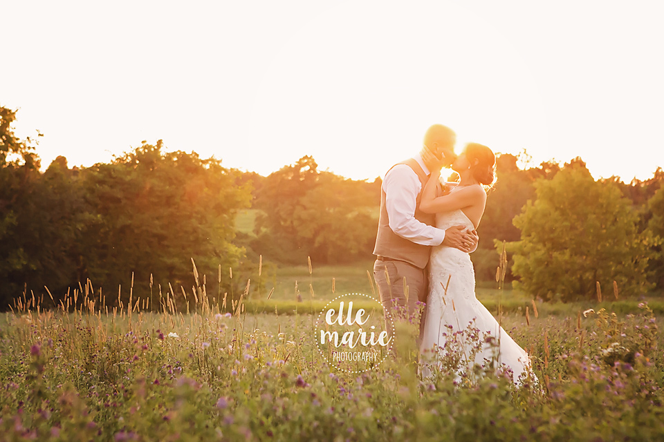 bride and groom at sunset at century barn